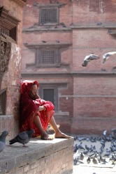 I was struck by the vibrant colour contrast of the woman contemplating life in Durbar Square, Kathamdu, Nepal with the ...
