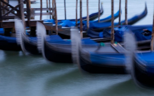 These gondolas famous on the island of Venice bobbed up and down on the Canale de San Marco.