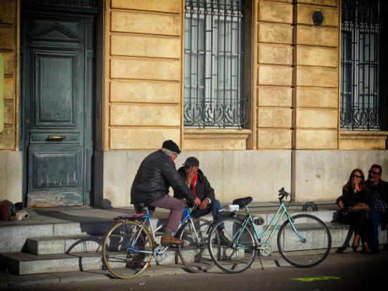 Two old cycling friends meet in the town square of Arles in Southern France. The French are keen cyclists and ...