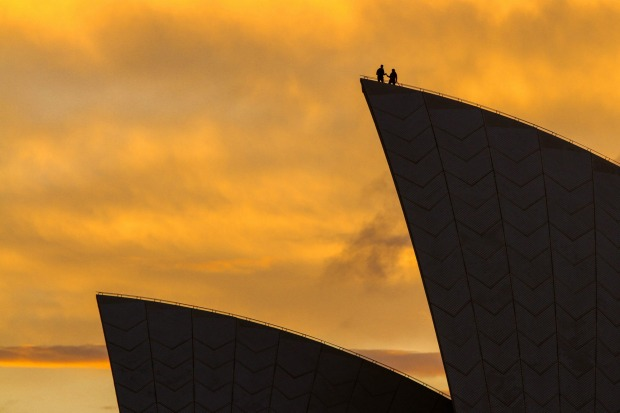 A lucky couple watching the sunrise on Valentines Day, from the top of the Sydney Opera House sail. Photo taken on 14 ...