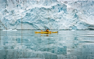 Kayaking in the Arctic in from of Svalbards beautiful Glaciers.