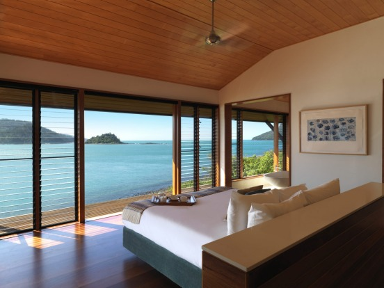 Bed with a view at a Windward Pavilion at Qualia.