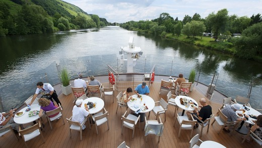 Enjoying river scenery from the deck of a Viking ship.