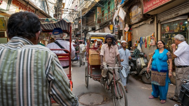 Take a trishaw ride through the narrow streets of Old Delhi.