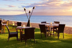 The tables at Relish are set up next to Ka'anapali Beach.