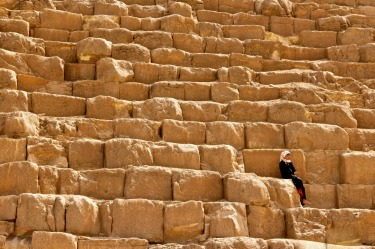 Girl resting on the Great Pyramid of Giza.