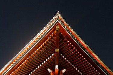 In the grounds of the popular Sensoji Temple, Asakusa, Tokyo, Japan. Looking up at a stunning temple roof at night.