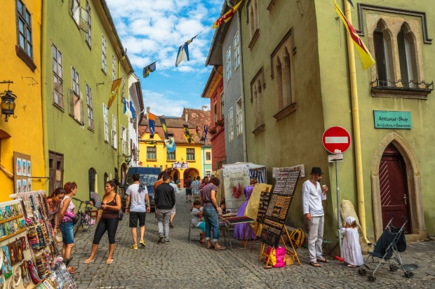A traditional craft market in the citadel of Sighisoara, one of the few still inhabited citadels in Europe, and a UNESCO ...