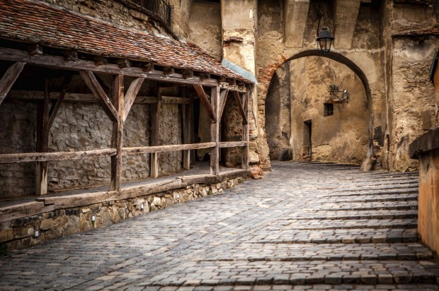 Medieval street view in Sighisoara, founded by Saxon colonists in XIII century.