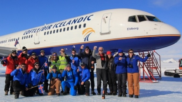 Loftleidir Icelandic staff celebrate after making the first landing of the commercial Boeing 757 in Antarctica.
