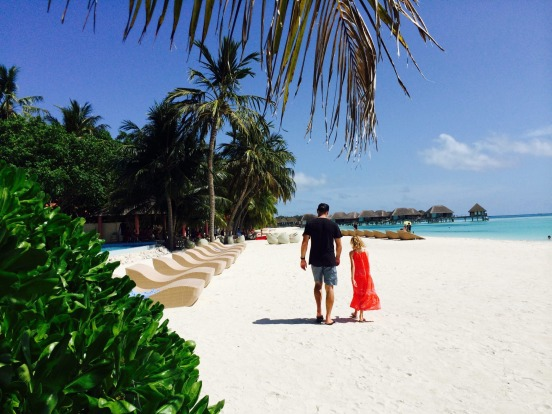 A father-daughter walk on the beach at Club Med Kani.