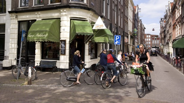 Feel the wind in your hair while you cycle in Amsterdam.