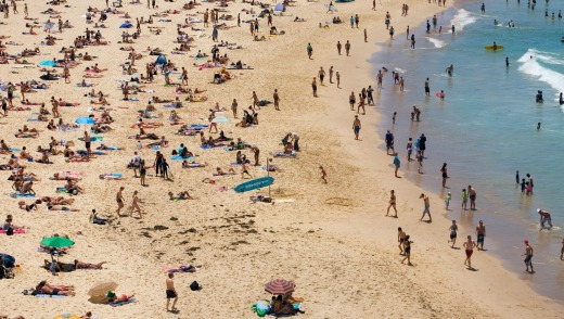 Summer crowds on the sands of Bondi Beach.