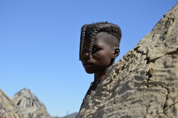 At a Himba village in Northern Namibia  the children gathered round wanting their photos taken. This young girl was ...