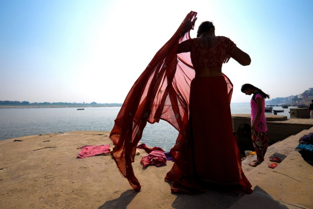 I was sitting on the ghats of the Ganges in Varanasi when these women came along to bathe and wash their clothes.  One ...