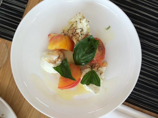 Buffalo mozzarrella with heirloom tomatoes, basil and balsamic vinegar.