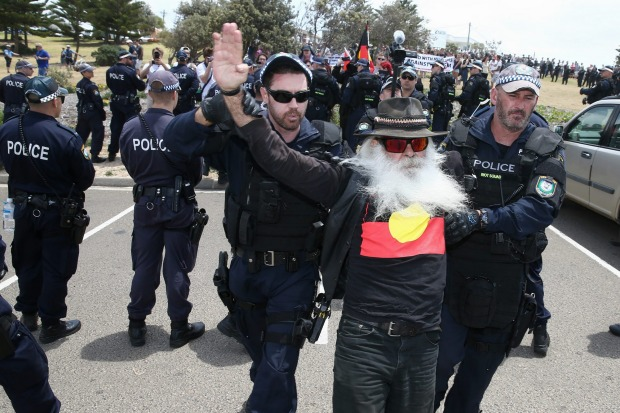 A man from anti-racism rally is arrested during the march along the beach in Cronulla.