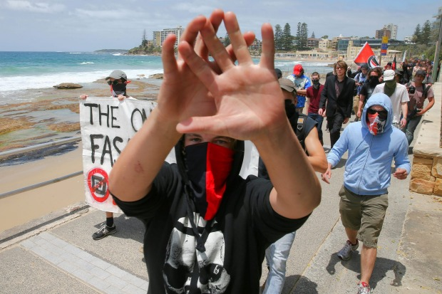 A man who didn't want to be photographed from the anti-racism rally during the march along the beach in Cronulla.