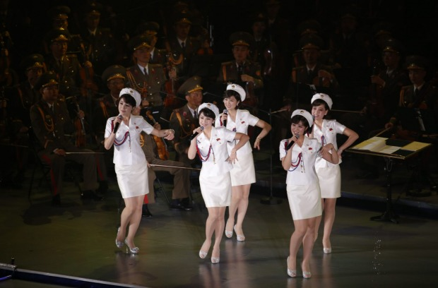 Members of North Korea's Moranbong band sing and dance during a joint performance with the State Merited Chorus in ...