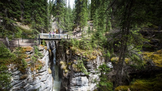 Two women look at Maligne Canyon.