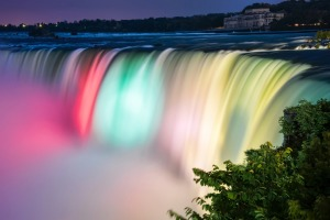 Niagara falls lit by colorful lights of many colors