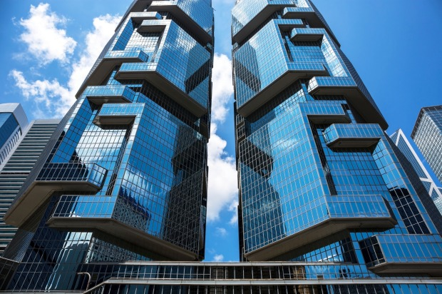 Lippo Centre, Hong Kong: This distinctive set of twin towers in a city of many daunting skyscrapers is supposed to bear ...