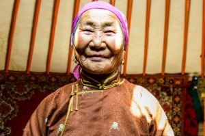 A Mongolian nomad inside her ger,