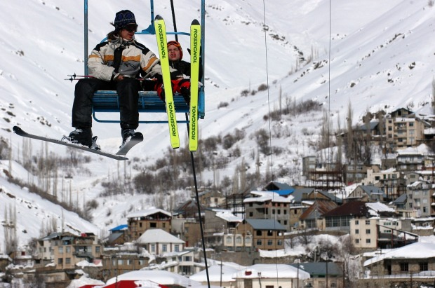 Skiers take the lift at the Shemshak ski resort north of Tehran, Iran.