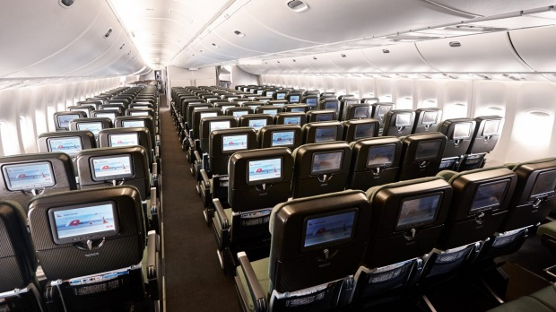 The rear of an economy cabin on board a Qantas 747 jumbo jet where the configuration changes to 2-4-2.