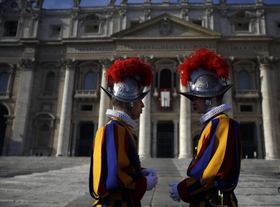 St. Peter's Basilica, Vatican City, Italy: Two Swiss Guards stand in St. Peter's Square at the Vatican.