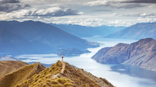 A tourist takes in the sights at Lake Wanaka.