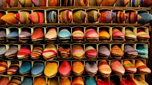Brightly coloured Moroccan slippers (babouches) in souk, Marrakesh.