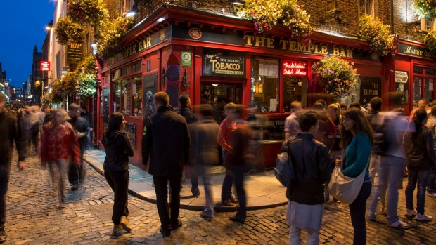 Dublin famed Temple Bar pub district at night.
