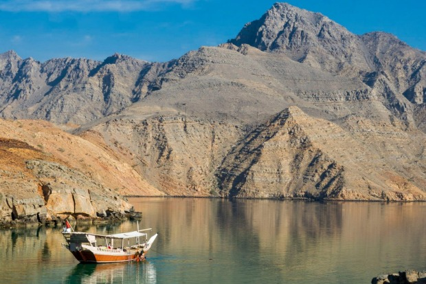 Cruise in the fjords on a dhow, traditional wooden ship in Oman.