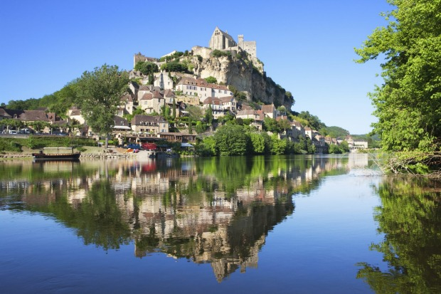 Castle and river Dordogne, France.