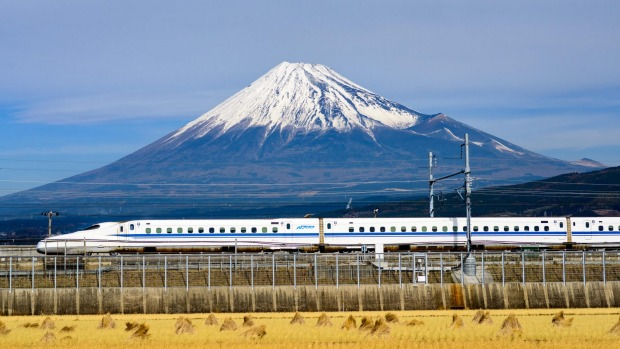 A bullet train passes below Mt Fuji in Japan.