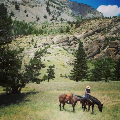 Trail riding in the Sawtooth Mountains on a perfect Montana summer's day. The cowgirl is Meaghan from JJJ Guest Ranch ...