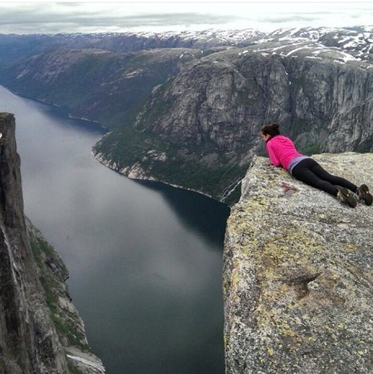 Admire the amazing view from Preikestolen, or The Pulpit Rock, which towers 604 metres above Lysefjord in Norway.