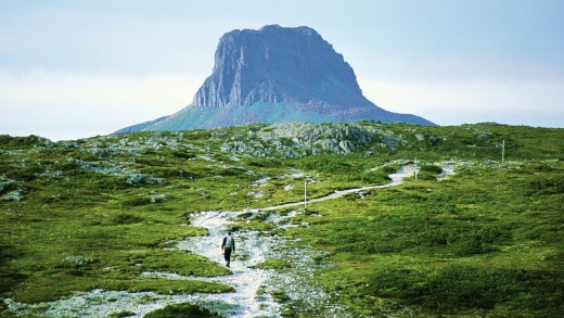 A hiker walks at Barn Bluff at Cradle Mountain Lake, in Tasmania.