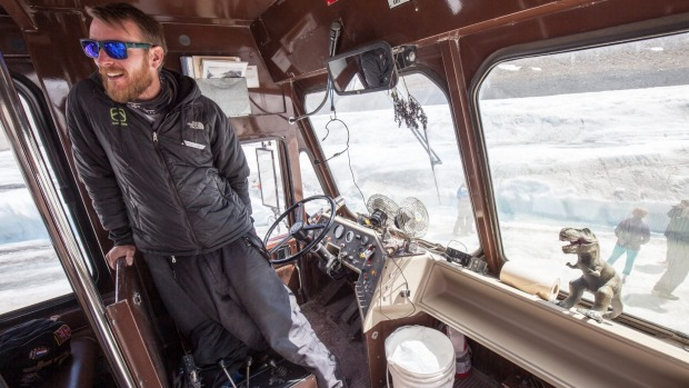 Guide Michael Rex with T Rex mascot inside his Ice Explorer.