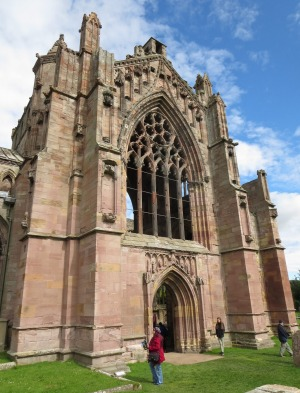 The rose-coloured exterior of Melrose Abbey.