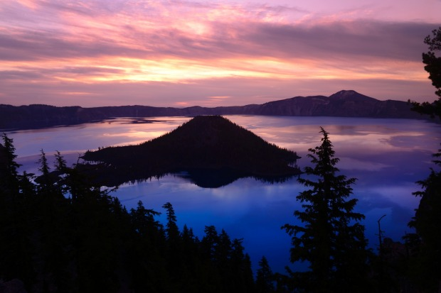 View over Wizard Island at sunrise, Crater Lake National Park.
