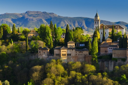 Alhambra Palace and Sierra Nevada mountains, Granada, Spain.