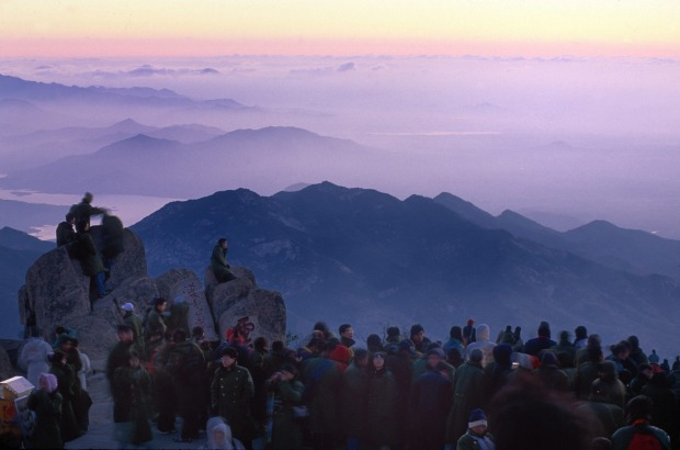 Crowds gather to see the sunrise from China's famed Mt. Tai.