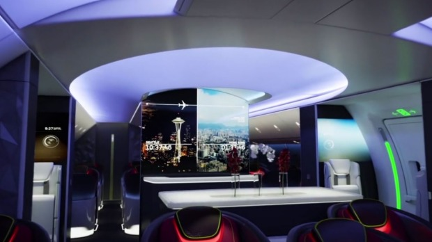 The future of Boeing plane cabins will feature video screens on the ceiling and bulkheads.