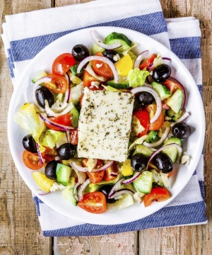 Greek salad of organic vegetables with tomatoes, cucumber, red onion, olives and feta cheese.