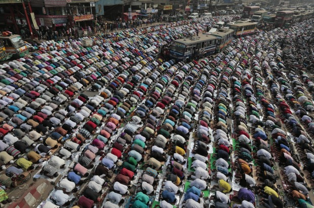 Bangladeshi Muslim devotees offer prayers during the first day of an Islamic congregations second phase in Tongi, north ...