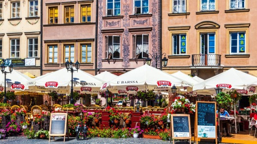 Outdoor bars and restaurants in Stary Rynek, Old Town Market Place in Warsaw, Poland.