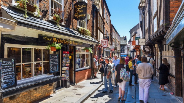 Pubs, shops and cafes on the historic Shambles, York, North Yorkshire, England.