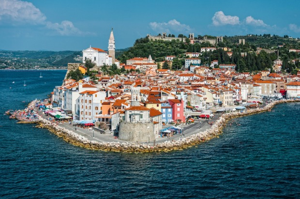 SLOVENIA: Slovenia packs in a Mediterranean coastline, the peacock-blue lakes and ski resorts of its gorgeous alps, ...